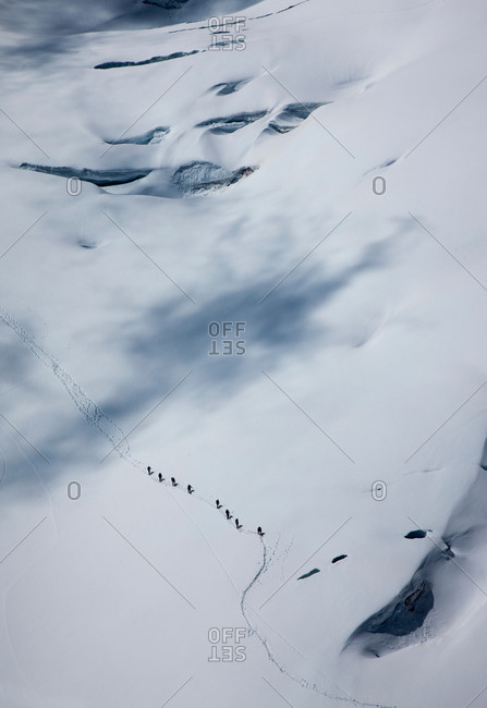 Distant high angle view of climbing team crossing glacier at  Mont Blanc, Chamonix, Haute Savoie, France