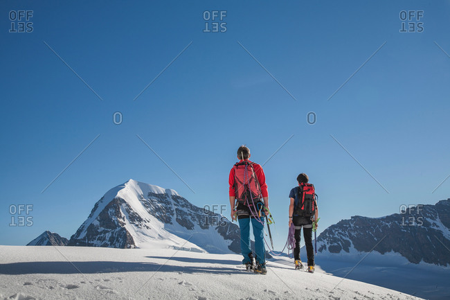 Rear view of two male climbers moving up, Canton Bern, Switzerland
