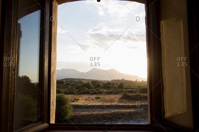 Open window view of rural landscape at dusk, Calvi, Corsica, France