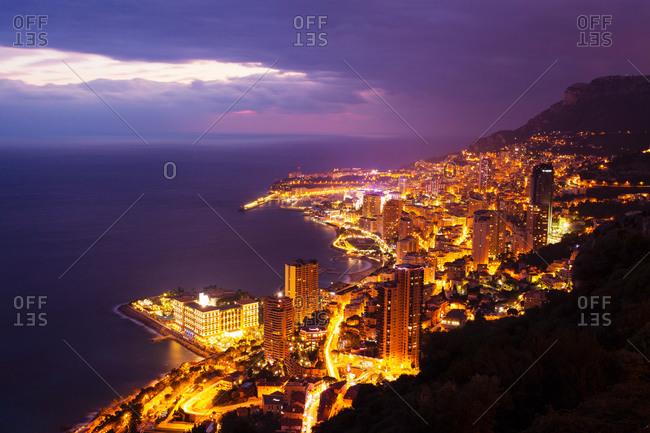 High angle view of Monte Carlo city lights at night, Monaco