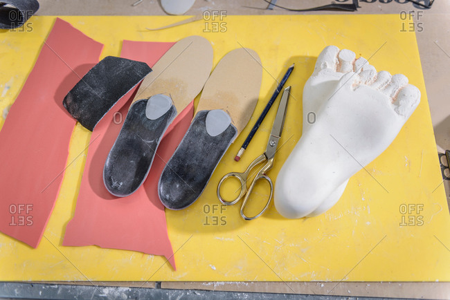 Shoe insoles made from plaster casts of feet in medical factory