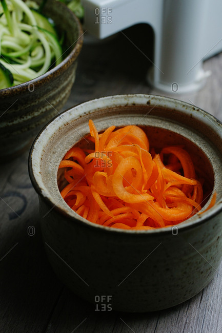 Small ramekins filled with spiral cut carrot and zucchini