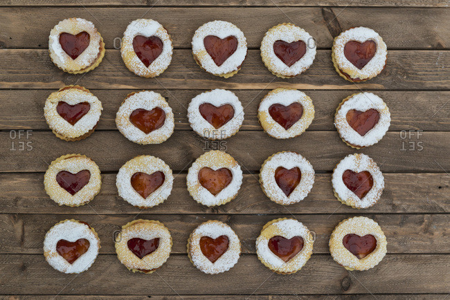 Rows of jam filled cookies with heart cut-outs