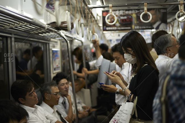 Tokyo, Japan - July 21, 2013: People riding the subway in Tokyo