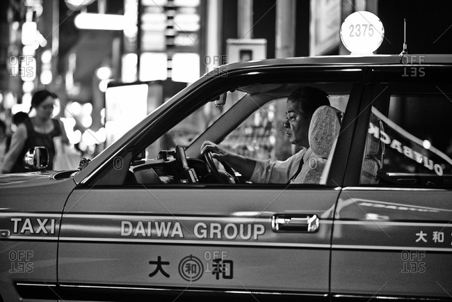Tokyo, Japan - July 19, 2013: Asian man driving a taxi