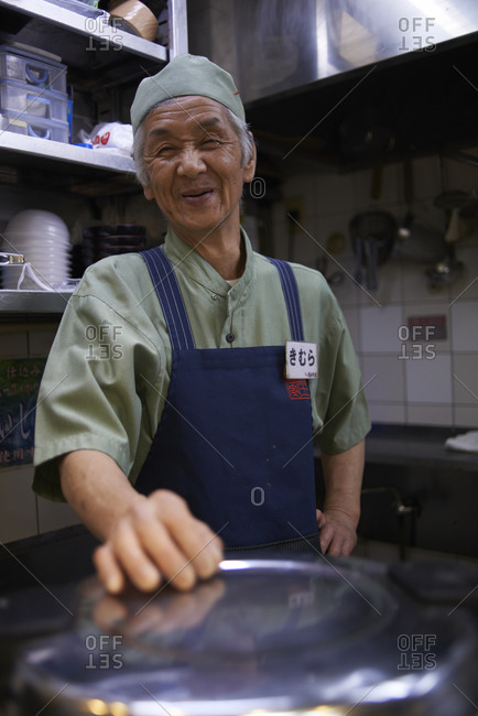 Tokyo, Japan - July 19, 2013: Portrait of an Asian man in a kitchen
