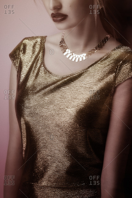 Close up of young woman wearing a gold dress