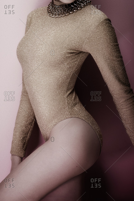 Woman wearing a gold sparkly leotard