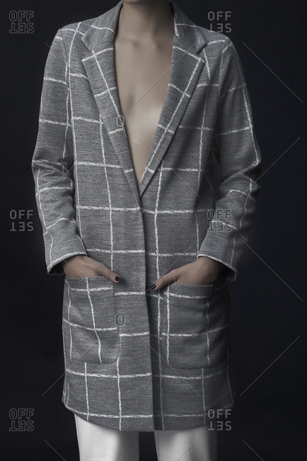 Woman wearing gray and white checkered coat