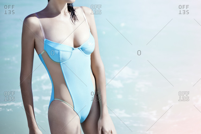 Young woman wearing a blue bathing suit