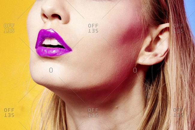 Close up of woman wearing purple lipstick