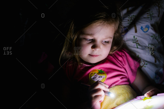 Flashlight stock photos offset a young girl using a small pen flashlight to read a book in bed sciox Gallery
