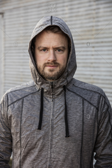 Man in hooded running jacket