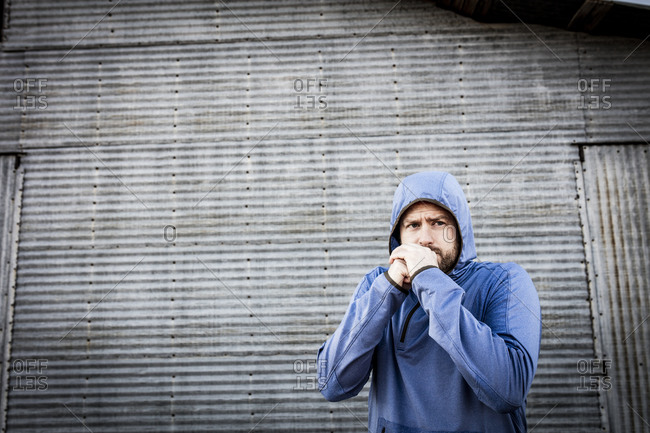 Man in running jacket shivering