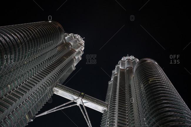 Kuala Lumpur, Malaysia - February 15, 2015: Low angle view of twin towers in Kuala Lumpur at night