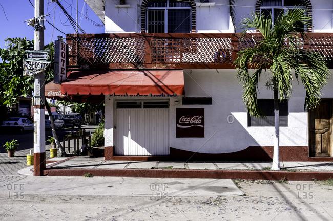 Barra De Navidad, Mexico - February 4, 2016: Exterior of a corner hotel, Mexico