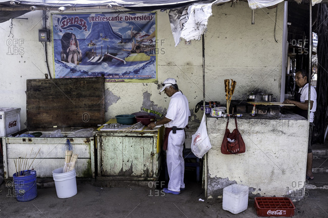 Barra De Navidad, Mexico - February 14, 2016: Two men at Mexican street food stand