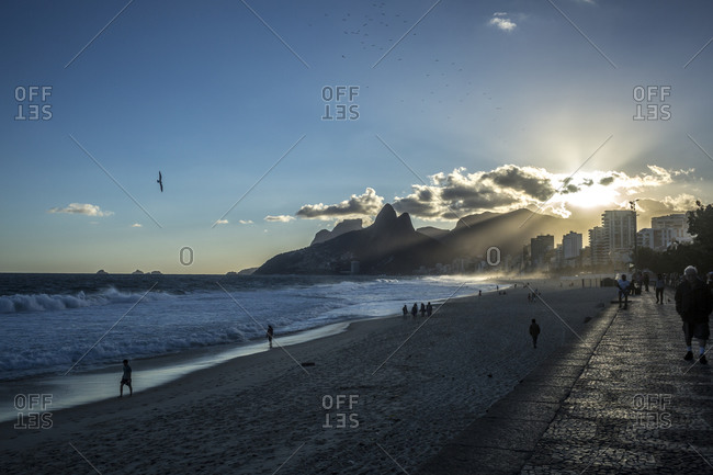People on Ipanema Beach in sunlight