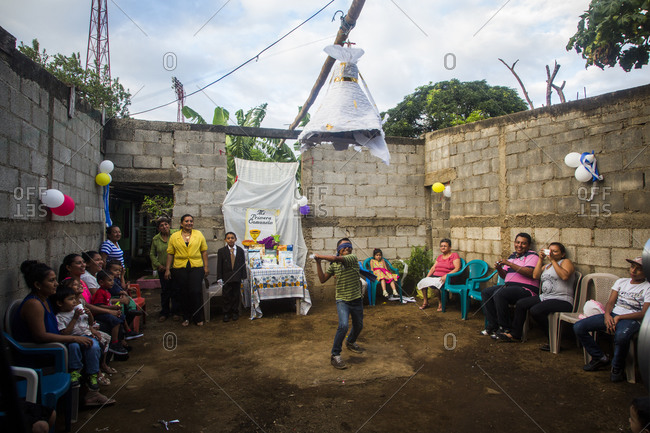 Masaya, Nicaragua - December 8, 2015: A young boy celebrates his party at home with a pinata and friends