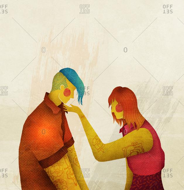 Woman touching a man's chin
