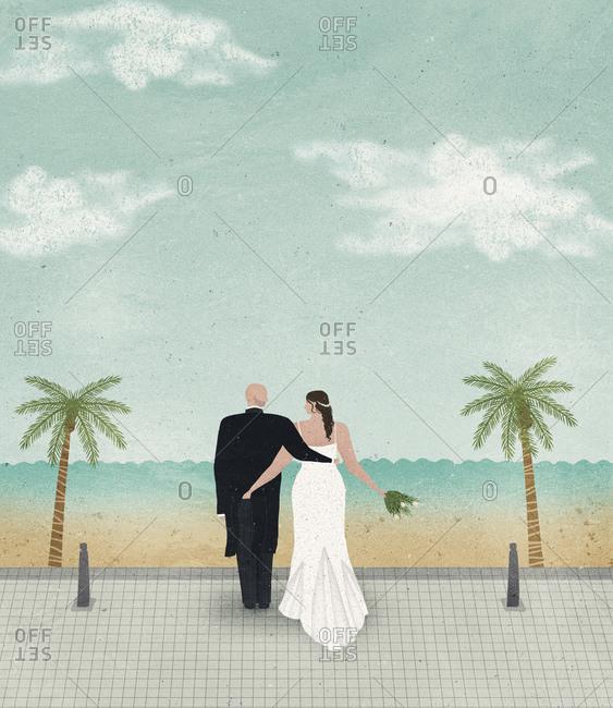 Bride and groom looking at sea