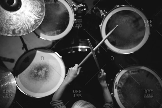 Overhead View Of Child Playing Drum Kit Stock Photo Offset