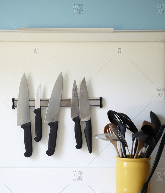 Kitchen knives hanging on the wall