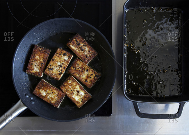 Seared tofu slices in a pan