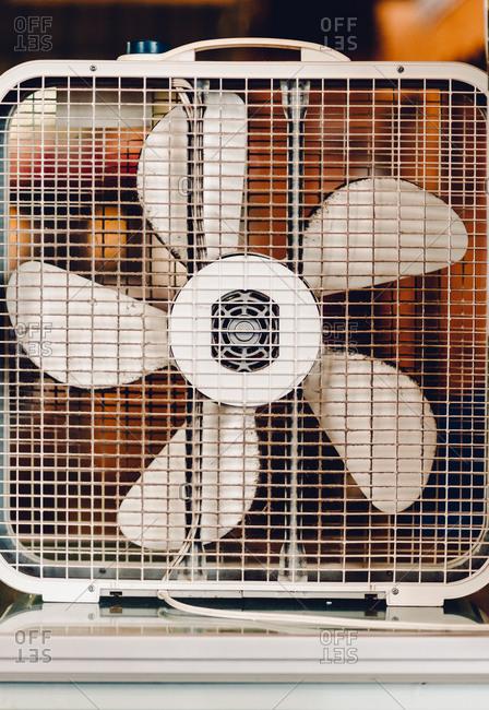 Dusty box fan in window