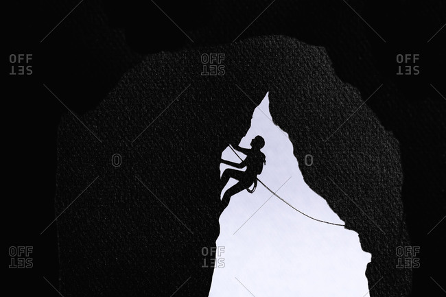 Cardboard cutout of a rock climber climbing in a cave