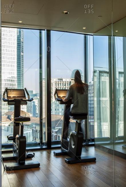 Woman riding a stationary exercise bike the Shiseido Spa, Gallia Hotel, Milan