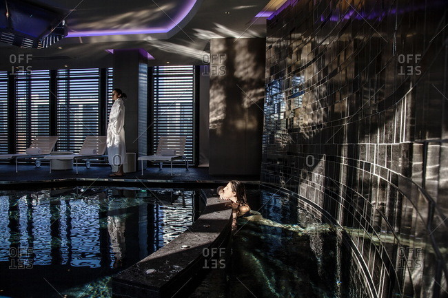 Women relaxing in the hot tub and by the swimming pool at the Shiseido Spa, Gallia Hotel, Milan