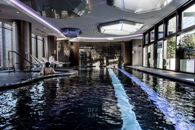 Women relaxing in the hot tub and lounging by the swimming pool at the Shiseido Spa, Gallia Hotel, Milan