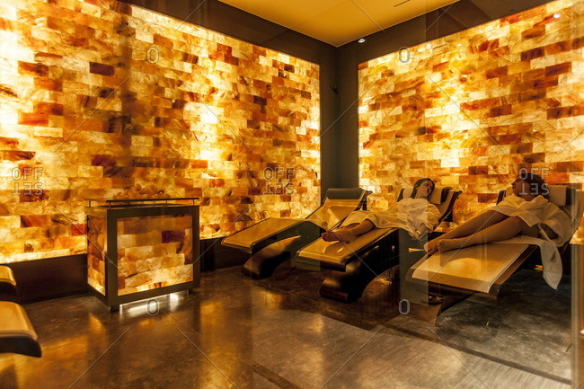 Two women talk with each other while relaxing in the sauna at the Shiseido Spa, Gallia Hotel, Milan