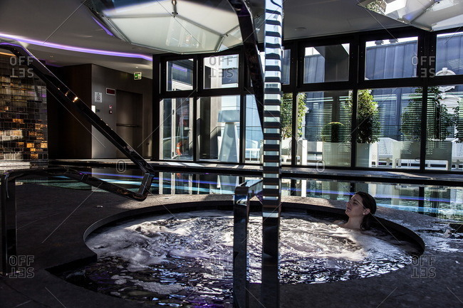 Woman relaxing in the hot tub at the Shiseido Spa, Gallia Hotel, Milan