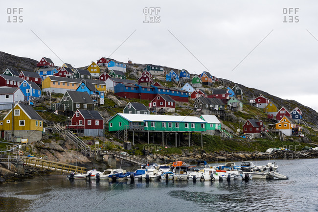 An arctic fishing community perched on a rugged, barren island