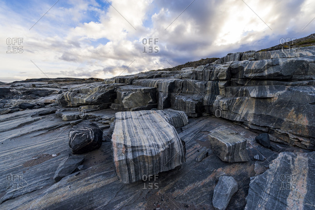 Striations carved into a bedrock by ice erosion as a glacier receded