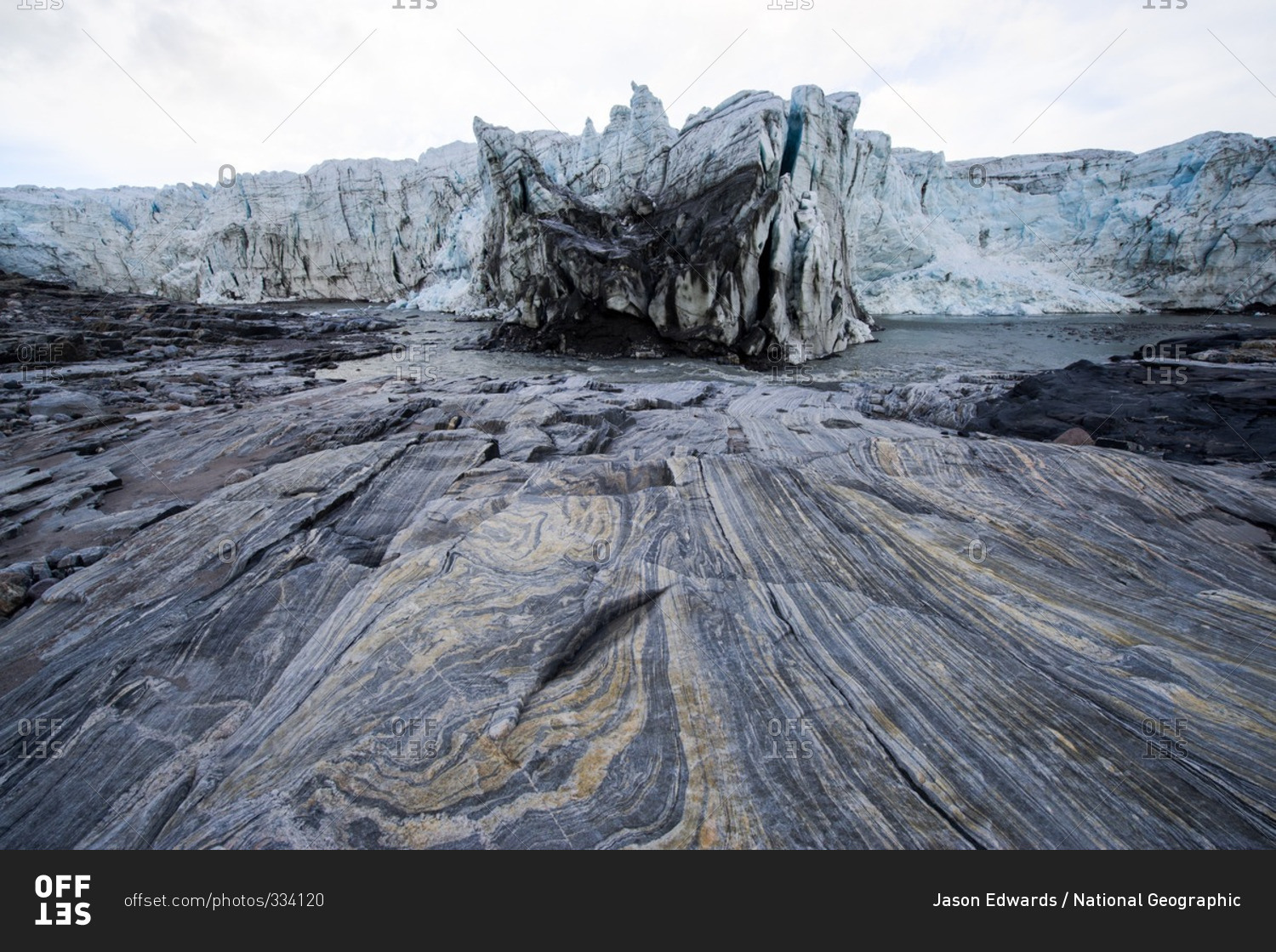 Striations carved into bedrock by ice erosion as a glacier