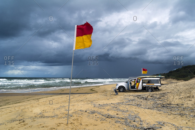 Yaroomba Beach, Queensland, Australia - April 11, 2013: A lifeguard patrol on a stormy beach