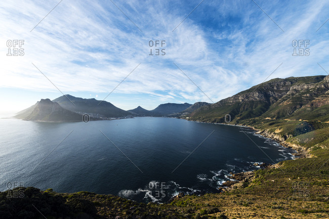 Picturesque and rugged mountains surrounding a bay on South Africa's coastline