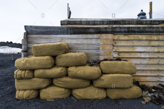 Hay bales to feed horses stacked against the wall of Antarctic explorer Robert Falcon Scott's hut
