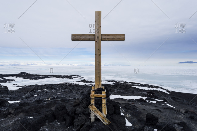 A cross is erected on a hill behind Scott's Hut in memory of the three members of Shackleton's Ross Sea Party, who died nearby