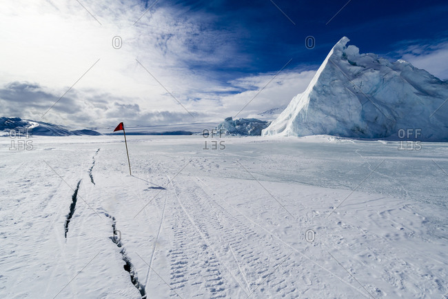 Cracks appear in melting sea ice during the summer in Antarctica