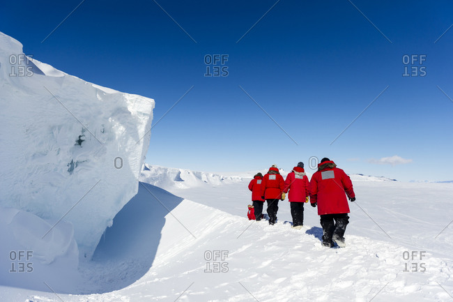 Staff from McMurdo Station exploring an ice cave in the Erebus Glacier Tongue