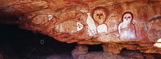 The rich ochre colours of an Aboriginal rock painting gallery featuring The Great Fish Chase