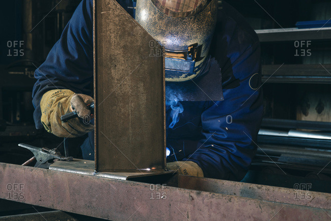 A man welding metal