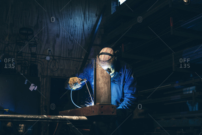 Man in welding mask at work