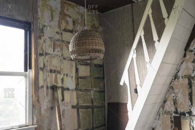 Light fixture in dilapidated room