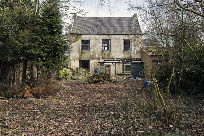 Dilapidated house with neglected yard