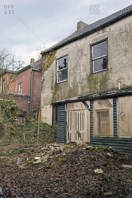 Dilapidated house with neglected backyard